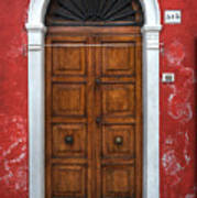 an old wooden door in Italy Poster by Joana Kruse