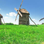 Ancient Windmills In Field Poster