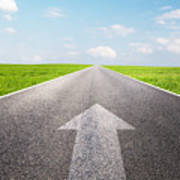 Arrow Sign Pointing Forward On Long Empty Straight Road Poster