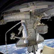 Astronaut Participates In A Spacewalk Poster
