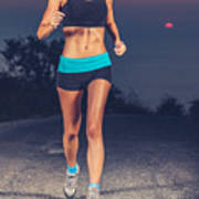 Athletic Woman Jogging Outdoors Poster