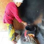 Balinese Lady Roasting Coffee Over The Fire Poster