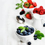 Berries In Bowls  On Wooden Background. Poster