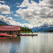 Boat House And Canoes On A Jetty At Maligne Lake In Canada Poster