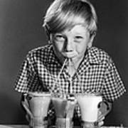 Boy Drinking Three Shakes At Once Poster