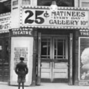 Boy In Front Of A Movie Theater Showing Poster