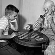 Boy Playing Checkers With Grandfather Poster