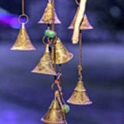 Brass Bells Hanging In The Illuminated Courtyard At Winter Night Poster