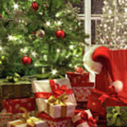 Brightly Lit Christmas Tree With Lots Of Gifts Poster