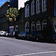 Buildings On Both Sides Of A Road Poster