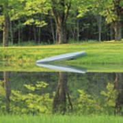 Canoe At Ponds Edge Poster