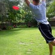 Catching Frisbee Poster