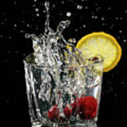 Cherries Splashing Into Sparkling Water Glass With Lemon Slice O Poster