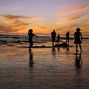 Children Playing On The Beach At Sunset Poster