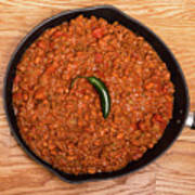 Chili In Black Pan On Wood Table With Jalapeno Pepper Poster