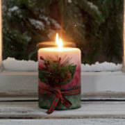 Christmas Candle Glowing On Window Sill With Snowy Evergreen Bra Poster
