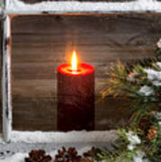 Christmas Red Candle With Snow Covered Home Window And Pine Tree Poster