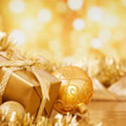 Christmas Scene With Gold Baubles And Gift On A Gold Background Poster