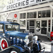 Classic Chevrolet Automobile Parked Outside The Store Poster