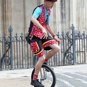 Clown Riding Unicycle In Town Poster