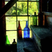 Colored Bottles On Steps Poster
