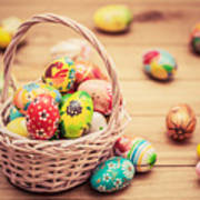 Colorful Hand Painted Easter Eggs In Basket And On Wood Poster