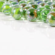 Composition With Green Marbles On White Background Poster