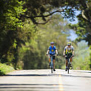 Couple Enjoying A Back Road Bike Ride Poster