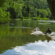 Couple Relaxing By The Shenandoah River At Harpers Ferry Poster