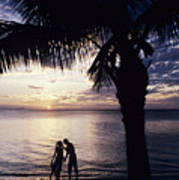Couple Silhouetted On Beach Poster