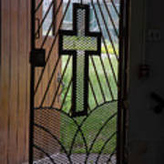 Cross On Church Door Open To Prison Yard Fence With Razor Wire Poster