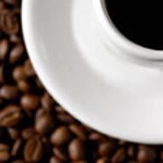 Cup Of Black Coffee On Coffee Beans Poster