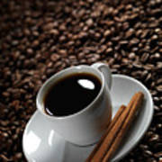 Cup Of Coffe On Coffee Beans Poster