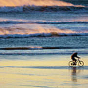 Cyclist Pedals Against The Wind At Pismo Beach Poster