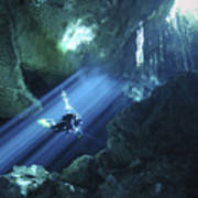 Diver Silhouetted In Sunrays Of Cenote Poster