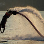 Flyboarder About To Enter Water With Hands Poster