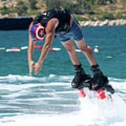 Flyboarder Bending Over To Dive Into Water Poster