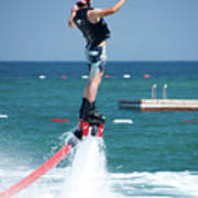 Flyboarder Falling Backwards Next To Swimming Platform Poster