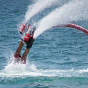 Flyboarder In Red Entering Water With Spray Poster
