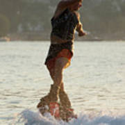 Flyboarder Twisting Upper Body Just Above Waves Poster