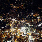 Flying At Night Over Cities Below Poster