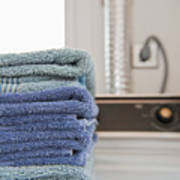 Folded Towels On A Dryer Poster by Thom Gourley/Flatbread Images, LLC