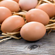 Fresh Organic Eggs On Rustic Wooden Boards And Straw Poster