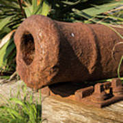 Front End Of An Old Rusty Cannon Lying On The Floor Poster