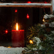 Glowing Christmas Candle In Frosted Home Window Poster