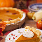 Homemade Pumpkin Pie On A Rustic Table With Autumn Decorations Poster