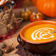 Homemade Pumpkin Soup On A Rustic Table With Autumn Decorations Poster