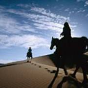 Horseback Riders In Silhouette On Sand Poster
