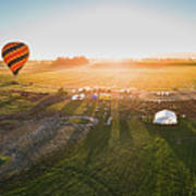 Hot Air Balloon Taking Off At Sunrise Poster