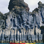Kayaking Past Cliffs Poster